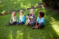Multiracial children with husky puppy