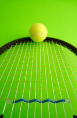 Tennis racquet on green