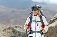 Woman trekking in mountains, Himalayas Nepal