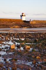 lighthouse on deserted beach
