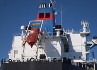 Modern oil tanker and orange lifeboat