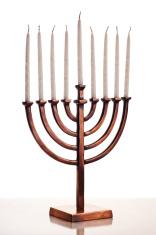 Beautiful unlit hanukkah menorah on white table.