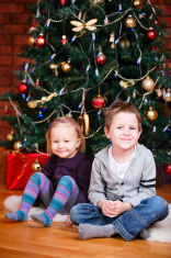 Two kids near Christmas tree