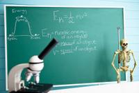 Kinetic energy formula on chalkboard in laboratory