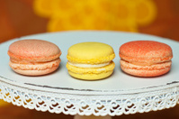 three colorful macarons on cakestand