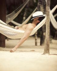man taking a hammock nap