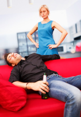 Drunk man having rest and angry wife