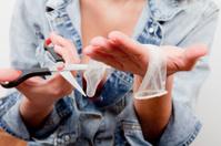 Woman Cuts a Condom