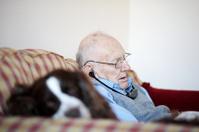 Senior man sleeping with his dog