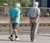 Two Senior Men Walking