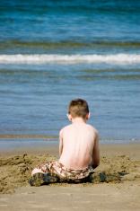 Boy plays on beach