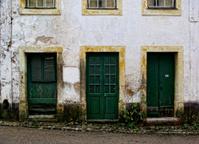 Three old green doors