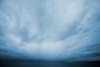 Dark, thunderous stormy sky over the ocean at dusk
