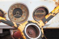 dusty vintage car speedometer white dash board