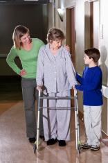 Family visiting elderly woman in hospital