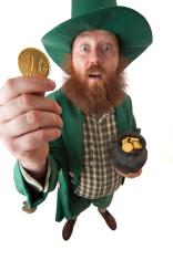 Gold coin in hand of leprechaun