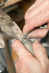 Jeweler Setting Diamond in a Wedding Ring Mount
