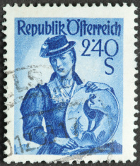 vintage woman's fashion on an old Austrian postage stamp