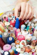 female hands choosing thread