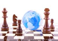 Blue globe on chessboard