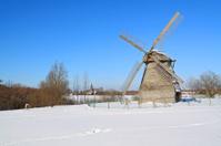 aging mill on snow field
