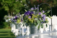 Green and Purple Bouquets in Tin Buckets at a Wedding