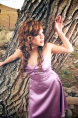 Pretty model in purple dress.