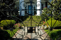 old mansion throught iron gate