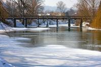Frozen river with bridge
