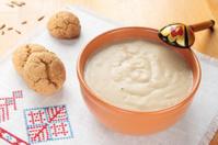Porridge in a ceramic bowl of oatmeal and oat cookies