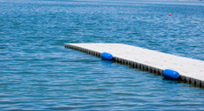 Pier leads out to blue water.