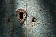Keyhole in weathered door