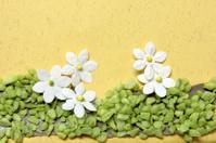 Handicraft flowers on a card