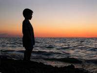 Boy at Beach Sunset