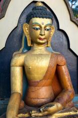 Closeup statue of sitting Buddha in Swayambhunath Temple