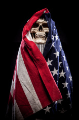 Skull on Pedestal Wrapped in American Flag, Closeup