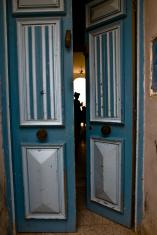 silhouette behind an open door