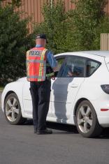 Police writing a speeding ticket