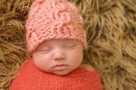 Sleeping Newborn Girl in Knit Hat