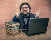Nerdy Man with Books and Laptop, Squinting at Cieling
