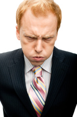 Funny Businessman mad face on White