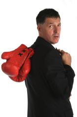 Buisness man with boxing gloves on the back