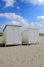 white beach houses along the Dutch coast