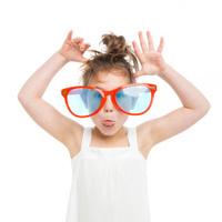 Little Girl Wearing Giant Sunglasses