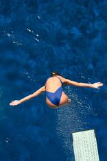 Springboard diver takes off