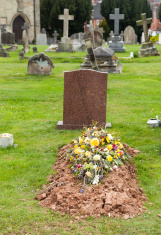Freshly dug grave in cemetery