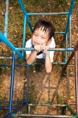 handsome asian kid in playground