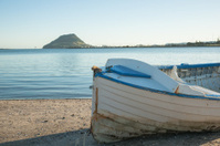 Old clinker dinghy on beach