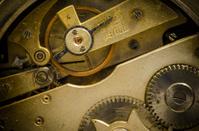 rusty internal gears of an ancient clockwork