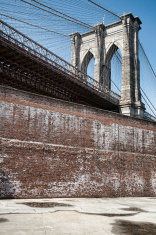 Brooklyn Bridge and brick wall New York